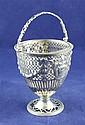 A George III pierced repousse silver sugar basket, 6 oz.