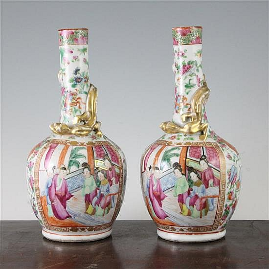 A pair of Chinese Canton decorated famille rose bottle vases