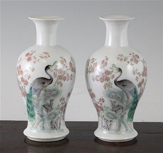 A pair of Chinese famille rose small baluster vases, 6in.
