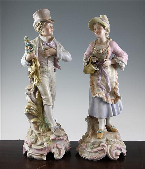 A pair of large Continental porcelain figures