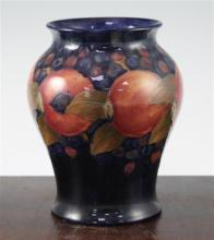 Two William Moorcroft pomegranate pattern vases, c.1916-25, 19cm, latter heavily repaired