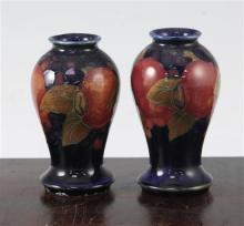 A pair of William Moorcroft miniature pomegranate baluster vases, c.1920, 9.7cm and 10cm