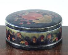 A William Moorcroft pomegranate circular box and cover, c.1920, 16cm