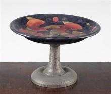 A William Moorcroft pomegranate pattern Tudric pewter mounted comport, c.1920, diam. 22cm