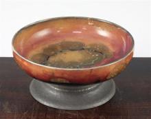 A William Moorcroft Eventide pattern pewter footed bowl, c.1925, diam. 18.5cm, rim repaired