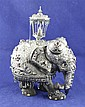 An early 20th century Indian gem set silver mounted bone and ebony model of a caprisoned elephant, 10.25in.