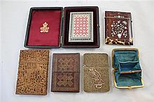 A collection of various card cases,