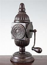 A rare Charles II rose engine-turned lignum vitae coffee grinding mill, c.1660, 13.25in.