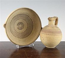 An ancient Cypriot pottery bowl and a similar jug, 1000-600BC, 9.5in. & 6.75in.