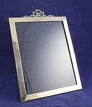 An Edwardian silver ribbon top photograph frame, overall 11.75in.