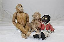An early 20th century Steiff monkey, similar monkey and golly dolls