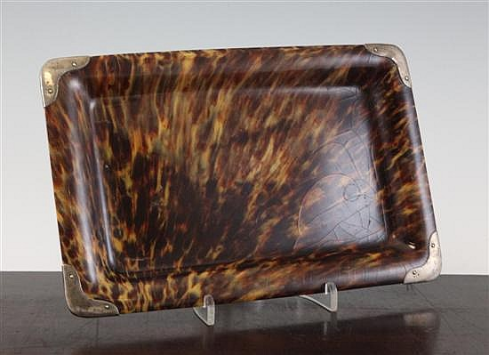 An Edwardian silver mounted tortoiseshell tray, 11in.