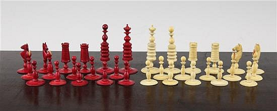 A 19th century turned carved and stained ivory chess set, kings 3in.