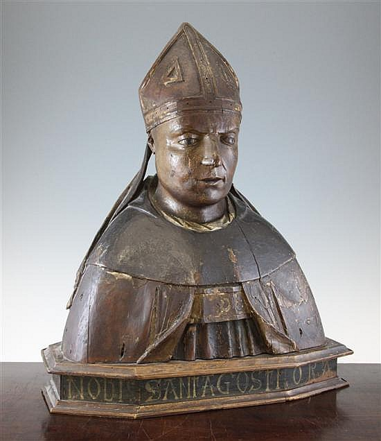 A late 18th century Italian carved giltwood and painted pine bust of a bishop Saint Augustine, 24 x 19in.