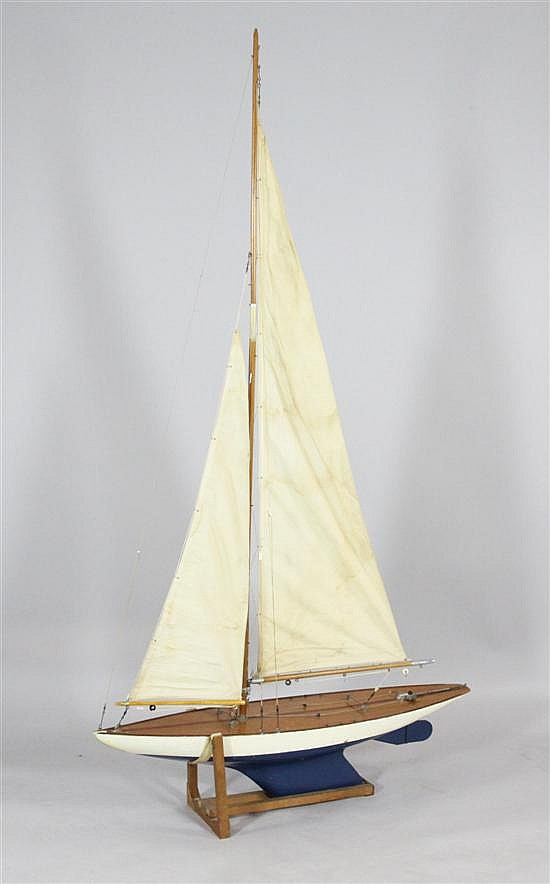 A model pond yacht, circa 1930, 64ins. x 36ins.