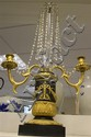 A pair of French Restoration period ormolu and bronze twin branch lustres, 28ins