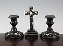 A pair of 19th century Derbyshire black marble dwarf candlesticks,