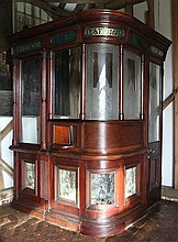 An unusual late Victorian part glazed mahogany cash booth, H.2.3m Length at longest 1.5m D. 1.3m.