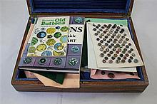A large collection of buttons & 2 books