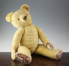 A large yellow plush covered teddy bear, probably Chad Valley, 29in.