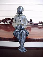 A late 19th century Austrian painted terracotta figure of a seated negro boy, 17in.