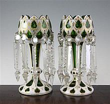 A pair of Bohemian green and white overlaid glass table lustres, late 19th century, 10.5in., one with fine crack