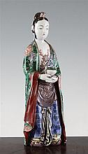 A Japanese Kutani porcelain figure of a Buddhist deity, late 19th century, 30.5cm.
