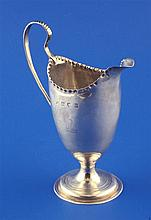 A George III silver helmet shaped cream jug by Hester Bateman, 5.25in.