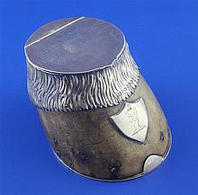 A Victorian silver mounted horse hoof inkwell with military related inscription, height 3in.