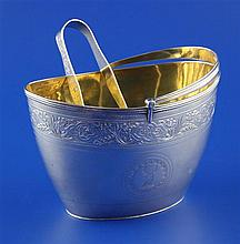 A George III silver oval sugar basket & earlier tongs, 7.5 oz.