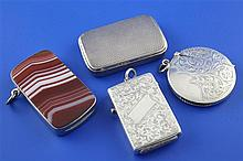 A Victorian silver rectangular trick opening vesta case & 3 others.