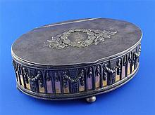 A 1930's Latvian 875 standard silver mounted oval trinket casket, 7.75in.