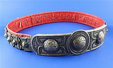 A late 19th century Russian 84 zolotnik silver and niello, red leather backed belt and buckle,