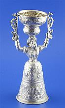 An unusual 19th century Hanau silver wager cup, modelled as a bearded man dressed as a lady, 12 oz.