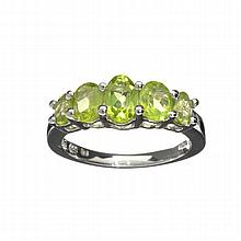 APP: 1.4k 2.30CT Oval Cut Green Peridot And Platinum Over Sterling Silver Ring