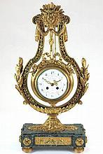 Reloj francés de sobremesa en forma de lira de bronce y base de mármol esti