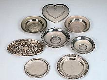 Lote de siete platillos de plata y una tapa en forma de corazón 257,6