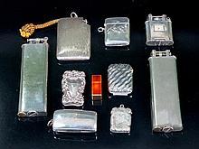 Lote de tres mecheros y cinco cerilleros de metal y plata 13,5 x 4,5 c