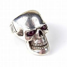 Silver skull ring. Set with ruby eyes and engraved with the words, 'Memento