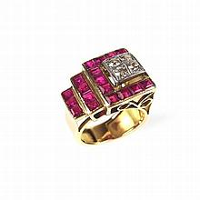 Yellow gold ruby and diamond ring. Of geometric form set with four round br