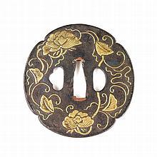 A Japanese iron tsuba, Edo Period. Of circular for