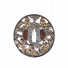 A very fine Japanese chiselled iron tsuba, late Ed