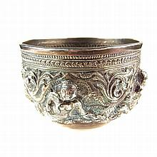 A Burmese silver bowl, 19th century. Of circular form, embossed to the exte