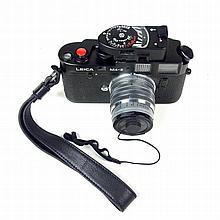 A Leica M4-2 camera. With an Ernst Leitz Wetzlar Summarit f=5cm 1:1,5 lens