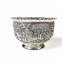 An Indian silver bowl, 19th century. Decorated to the exterior with a finel