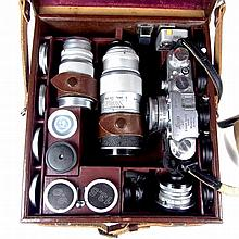 A Leica DRP Ernst Leitz Wetzlar camera with additional lenses, filters and