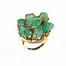 Yellow gold emerald cocktail ring, tests 18 ct. Comprising seven rough emer