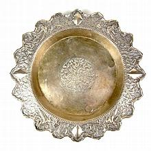 A Thai silver tray, late 19th/early 20th century. Of circular form, raised