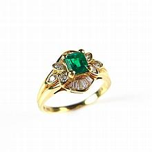 18 ct yellow gold emerald and diamond ring. The emerald cut emerald weighin