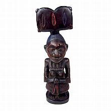 A Yoruba Shango female fertility shrine figure, Nigeria. 8.5 in (21.6 cm) h